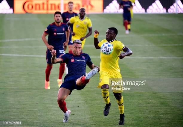 Francisco Calvo of Chicago Fire defends the ball from Derrick Etienne of Columbus Crew in the first half during their game at MAPFRE Stadium on...