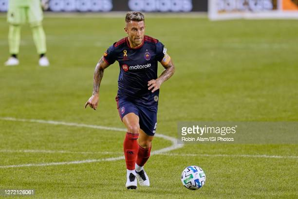 Francisco Calvo of Chicago Fire dribbles the ball during a game between New England Revolution and Chicago Fire at Soldier Field on September 06,...