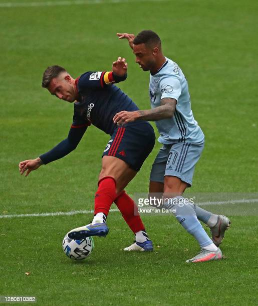 Francisco Calvo of Chicago Fire FC holds off Khiry Shelton of Sporting Kansas City at Soldier Field on October 17, 2020 in Chicago, Illinois. Chicago...