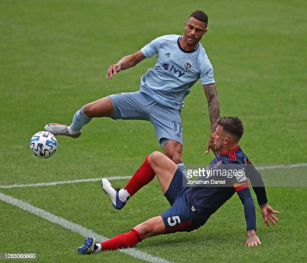 Francisco Calvo of Chicago Fire FC kicks the ball away from Khiry Shelton of Sporting Kansas City at Soldier Field on October 17, 2020 in Chicago,...