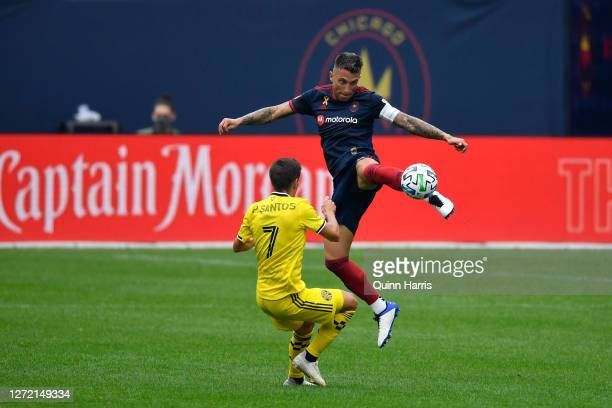Francisco Calvo of Chicago Fire jumps to kick the ball against Pedro Santos of Columbus Crew in the first half at Solider Field on September 12, 2020...