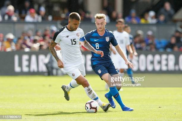 Francisco Calvo of Costa Rica is defended by Djordje Mihailovic of the United States during their international friendly match at Avaya Stadium on...