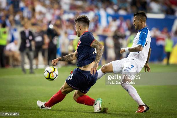 Francisco Calvo of Costa Rica strides to the ball against Carlos Discua of Honduras during the Group A CONCACAF Gold Cup Match between Honduras and...