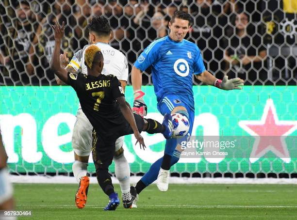 Francisco Calvo of Minnesota United defends as Bobby Shuttleworth of Minnesota United blocks a shot on goal by Latif Blessing of Los Angeles FC in...