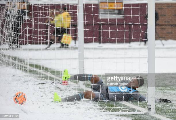 Francisco Calvo of Minnesota United FC slides into the net after a goal scored by Josef Martinez of Atlanta United FC during the second half of the...