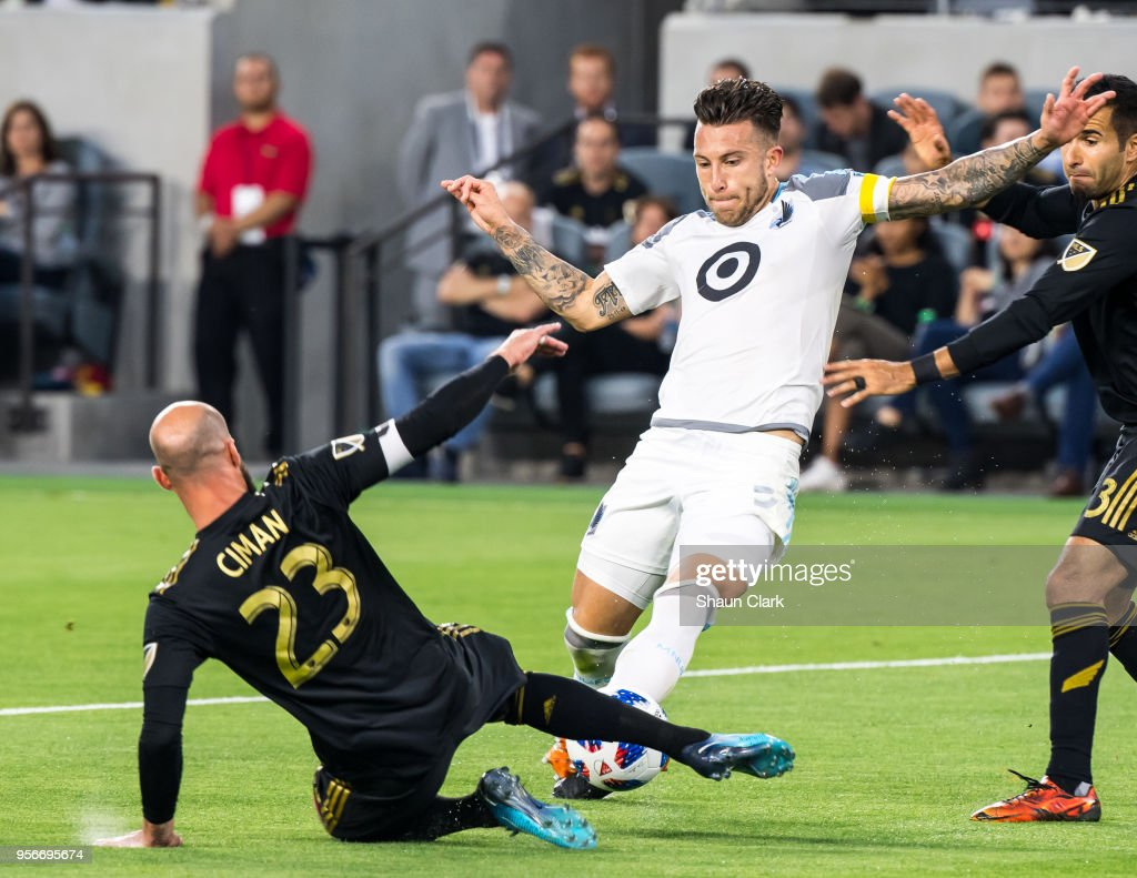 Francisco Calvo #5 of Minnesota United with the ball as Laurent Ciman #23 of Los Angeles FC defends during Los Angeles FC's MLS match against Minnesota United at the Banc of California Stadium on May 9, 2018 in Los Angeles, California. Los Angeles FC won the match 2-0
