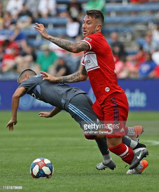 Francisco Calvo of the Chicago Fire knocks down Maximiliano Moralez of New York City FC as they battle for the ball at SeatGeek Stadium on May 25,...