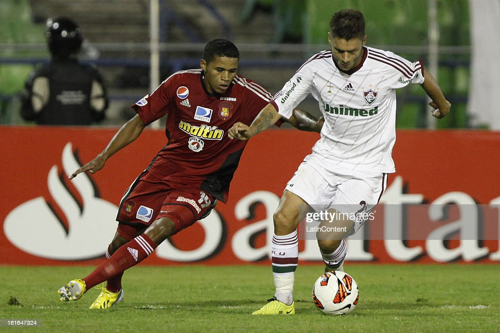 Francisco Carabali of Caracas FC fights for the ball with Rafael Sobis of Fluminense during a match between Caracas FC and Fluminense as part of the 2013 Copa Bridgestone Libertadores at the Olympic Stadium on February 13, 2013 in Caracas, Venezuela.