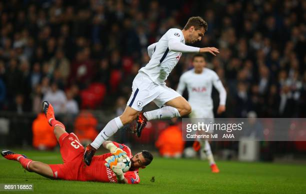 Francisco Casilla of Real Madrid saves from Fernando Llorente of Tottenham Hotspur during the UEFA Champions League group H match between Tottenham...