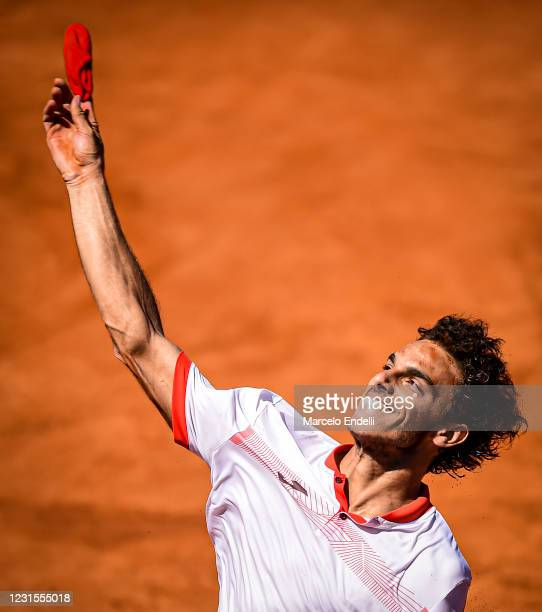 Francisco Cerundolo of Argentina celebrates after winning a semifinal match against Albert Ramos-Viñolas of Spain with a part of first semifinal...