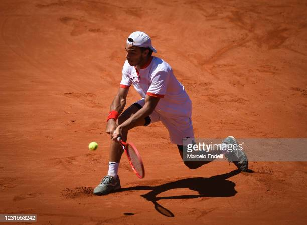 Francisco Cerundolo of Argentina hits a backhand during a match against Albert Ramos-Viñolas of Spain with a part of first semifinal during day 6 of...