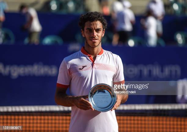 Francisco Cerundolo of Argentina poses with the finalist trophy after loses a Men's Singles Final match against Diego Schwartzman of Argentina as...