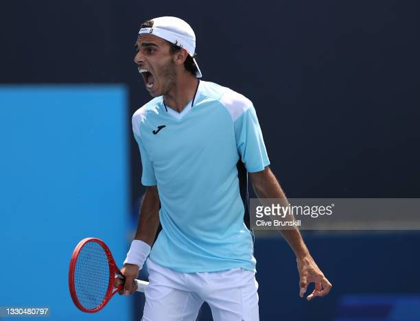Francisco Cerundolo of Team Argentina celebrates after winning a set point during his Men's Singles First Round match against Liam Broady of Team...