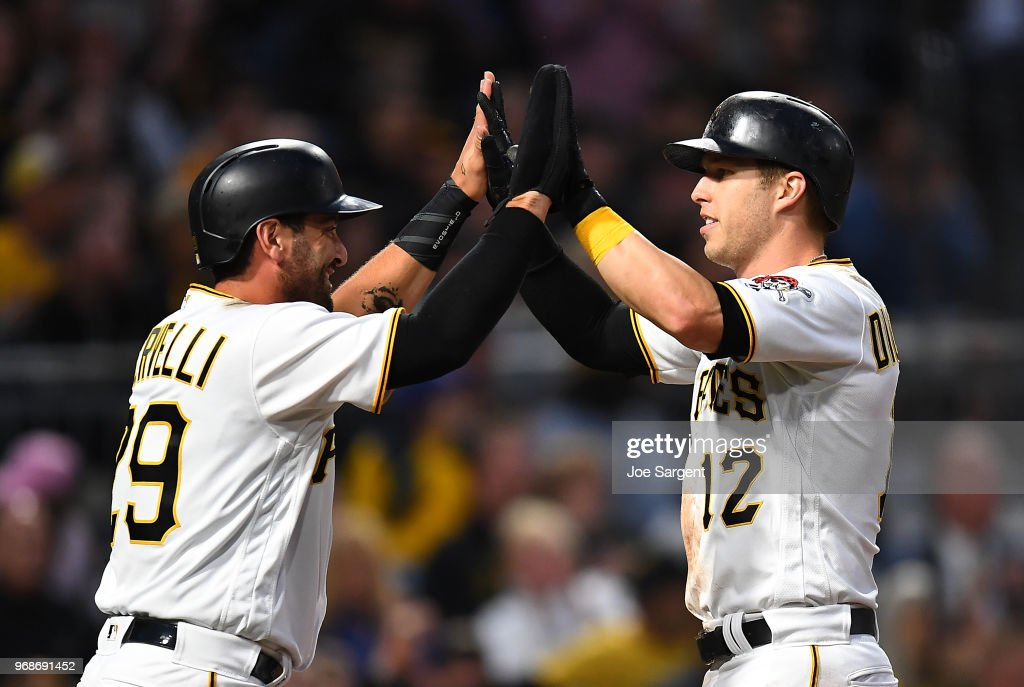 Francisco Cervelli #29 and Corey Dickerson #12 of the Pittsburgh Pirates celebrate after scoring during the fourth inning against the Los Angeles Dodgers at PNC Park on June 6, 2018 in Pittsburgh, Pennsylvania.