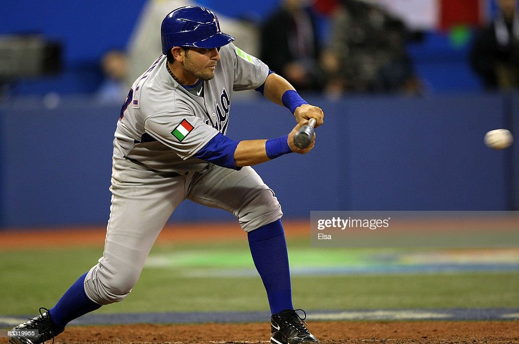Francisco Cervelli #64 of Italy hits a sacrifice bunt during the 2009 World Baseball Classic Pool C game on March 9, 2009 at the Rogers Centre in Toronto, Ontario, Canada. Italy defeated Canada 6-2.
