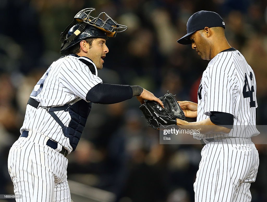 Francisco Cervelli #29 of the New York Yankees hands the ball to Mariano Rivera #42 as he enters the game in the ninth inning against the Boston Red Sox on April 4, 2013 at Yankee Stadium in the Bronx borough of New York City.The New York Yankees defeated the Boston Red Sox 4-2.