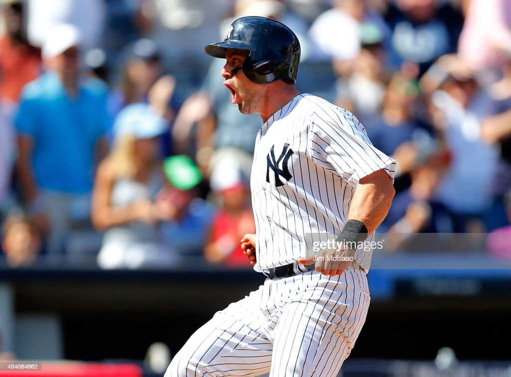 Francisco Cervelli #29 of the New York Yankees reacts after scoring the go ahead run in the sixth inning against the Chicago White Sox after a base hit from teammate Ichiro Suzuki at Yankee Stadium on August 24, 2014 in the Bronx borough of New York City.