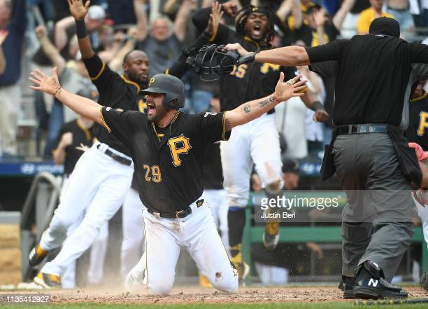 Francisco Cervelli of the Pittsburgh Pirates celebrates after scoring the winning run on a walk off double by Kevin Newman in the 10th inning during...