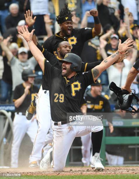 Francisco Cervelli of the Pittsburgh Pirates celebrates after scoring the winning run on a walk off single by Kevin Newman in the 10th inning during...