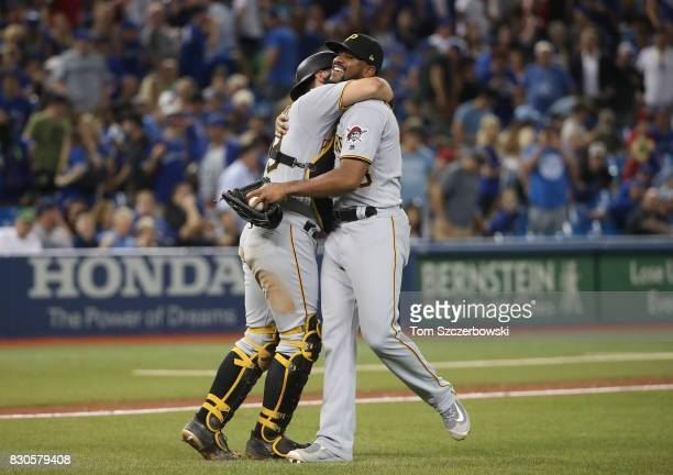 Francisco Cervelli of the Pittsburgh Pirates celebrates their victory with Felipe Rivero during MLB game action against the Toronto Blue Jays at...