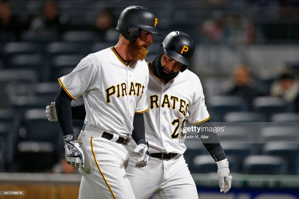 Francisco Cervelli #29 of the Pittsburgh Pirates celebrates with Colin Moran #19 of the Pittsburgh Pirates after scoring on Moran's sacrifice fly in the fifth inning against the Colorado Rockies at PNC Park on April 16, 2018 in Pittsburgh, Pennsylvania.