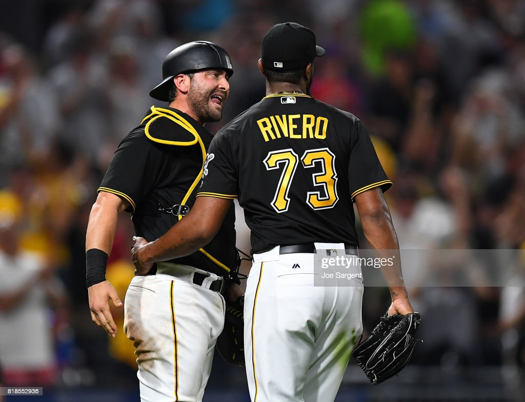 Francisco Cervelli #29 of the Pittsburgh Pirates celebrates with Felipe Rivero #73 after a 4-3 win over the Milwaukee Brewers at PNC Park on July 18, 2017 in Pittsburgh, Pennsylvania.