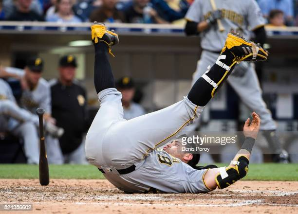 Francisco Cervelli of the Pittsburgh Pirates falls after being brushed back by a pitch during the fifth inning of a baseball game against the San...