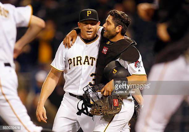 Francisco Cervelli of the Pittsburgh Pirates hugs Mark Melancon after defeating the Atlanta Braves 129 at PNC Park on May 17 2016 in Pittsburgh...