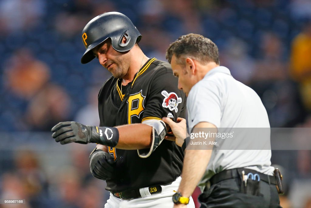 Francisco Cervelli #29 of the Pittsburgh Pirates is tended to by medical staff after being hit by a pitch in the third inning against the Chicago White Sox during inter-league play at PNC Park on May 15, 2018 in Pittsburgh, Pennsylvania.
