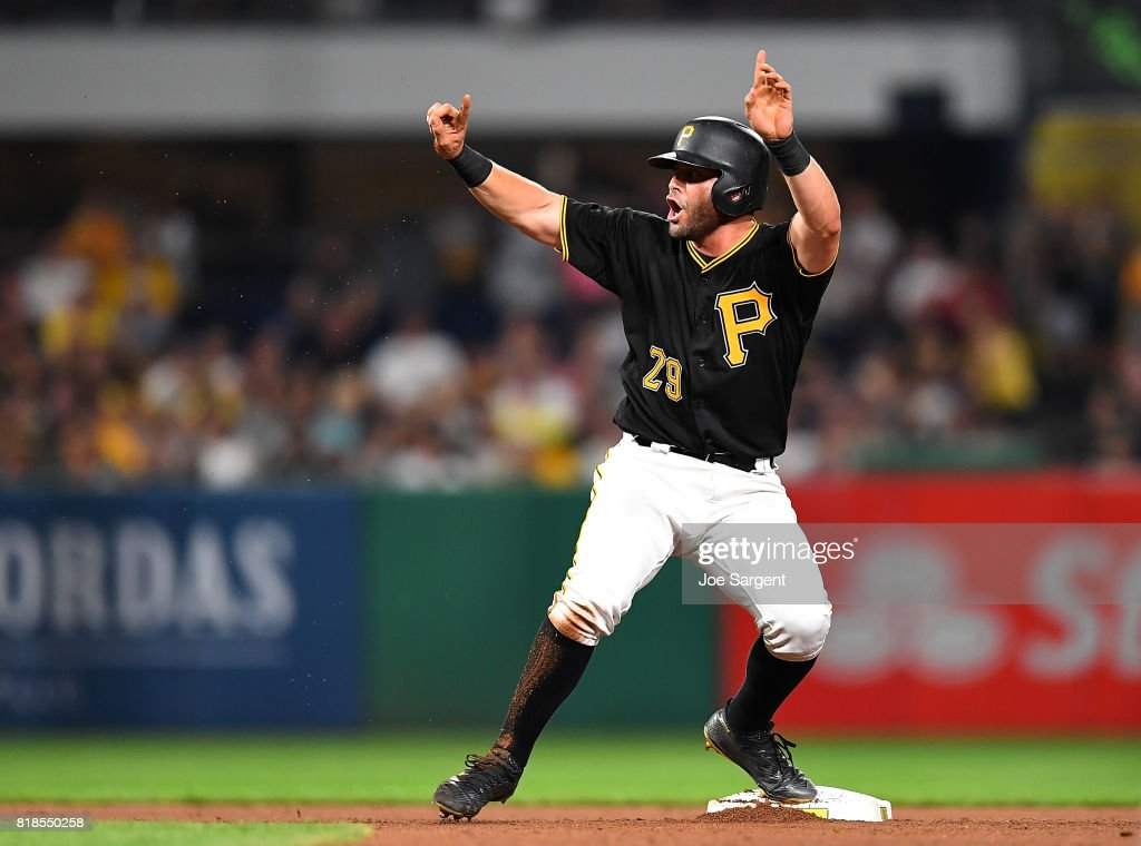 Francisco Cervelli #29 of the Pittsburgh Pirates reacts after being called out at second base during the seventh inning against the Milwaukee Brewers at PNC Park on July 18, 2017 in Pittsburgh, Pennsylvania. The call was overturned after a video replay challenge.