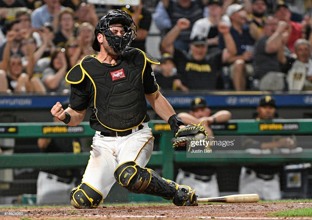 Francisco Cervelli #29 of the Pittsburgh Pirates reacts after tagging out Manny Pina #9 of the Milwaukee Brewers at home plate in the sixth inning during the game at PNC Park on July 17, 2017 in Pittsburgh, Pennsylvania.