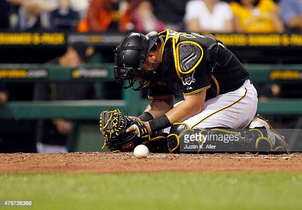 Francisco Cervelli of the Pittsburgh Pirates reacts after taking a foul tip in the seventh inning during the game against the San Diego Padres at PNC...