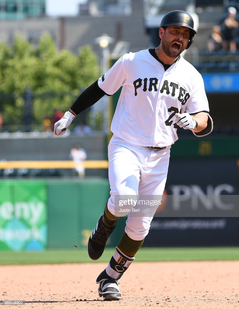 Francisco Cervelli #29 of the Pittsburgh Pirates reacts as he rounds the bases after hitting a home run in the ninth inning during the game against the Los Angeles Dodgers at PNC Park on June 7, 2018 in Pittsburgh, Pennsylvania.