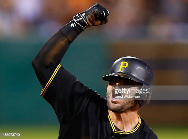 Francisco Cervelli of the Pittsburgh Pirates reacts following his triple in the 8th inning before scoring against the Chicago Cubs during the game at...