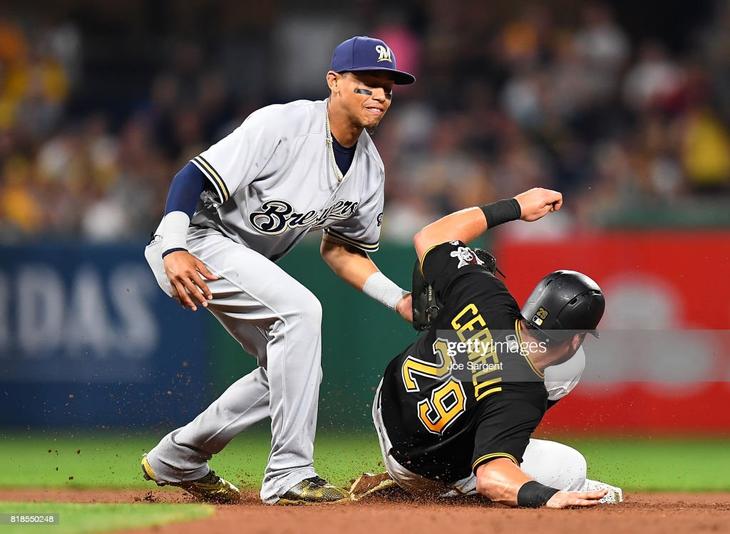 Francisco Cervelli #29 of the Pittsburgh Pirates slides safely into second base in front of Orlando Arcia #3 of the Milwaukee Brewers during the seventh inning at PNC Park on July 18, 2017 in Pittsburgh, Pennsylvania.