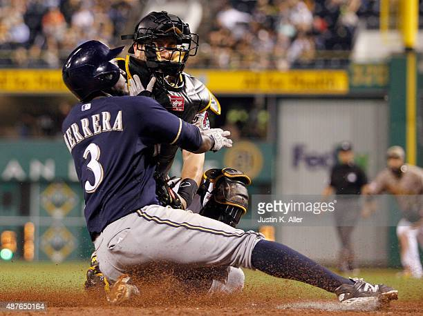 Francisco Cervelli of the Pittsburgh Pirates tags out Elian Herrera of the Milwaukee Brewers at home plate in the sixth inning during the game at PNC...