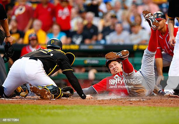 Francisco Cervelli of the Pittsburgh Pirates tags out Jose Lobaton of the Washington Nationals after his attempt on a pop fly in the fourth inning...