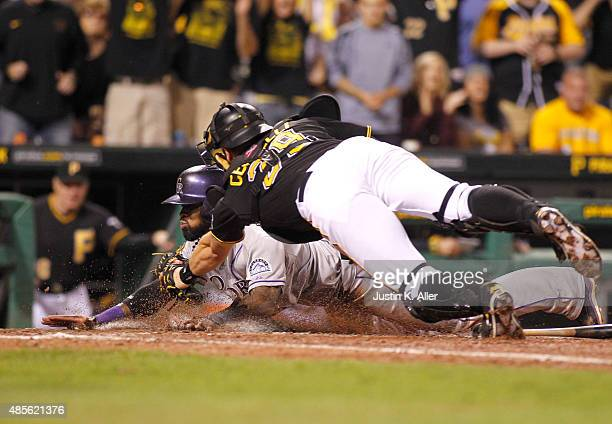 Francisco Cervelli of the Pittsburgh Pirates tags out Jose Reyes of the Colorado Rockies in the eighth inning during the game at PNC Park on August...