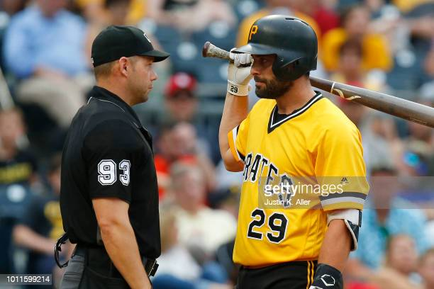 Francisco Cervelli of the Pittsburgh Pirates talks with home plate umpire Will Little after striking out in the eighth inning against the St Louis...