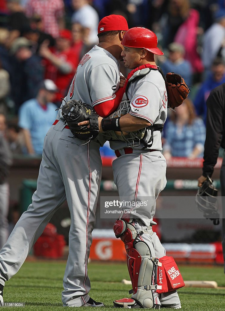 Francisco Cordero #48 of the Cincinnati Reds hugs catcher Ramon Hernandez #55 after a win against the Chicago Cubs at Wrigley Field on May 6, 2011 in Chicago, Illinois. The Reds defeated the Cubs 5-4.