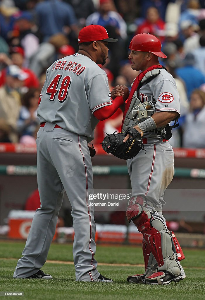 Francisco Cordero #48 of the Cincinnati Reds is congratulated by teammate Ramon Hernandez #55 after a win against the Chicago Cubs at Wrigley Field on May 8, 2011 in Chicago, Illinois. The Reds defeated the Cubs 2-0.