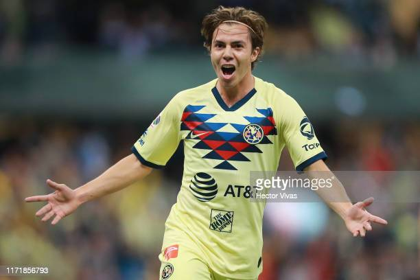 Francisco Cordova of America celebrates after scoring the first goal of his team during the 12th round match between America and Chivas as part of...