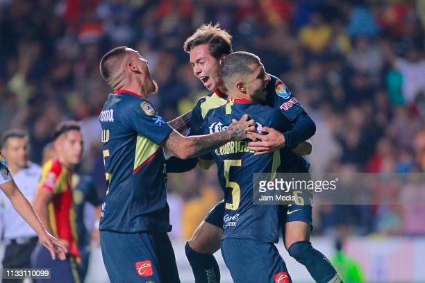 Francisco Cordova of America celebrates with teammates after scoring the second goal of his team during the 9th round match between Morelia and...