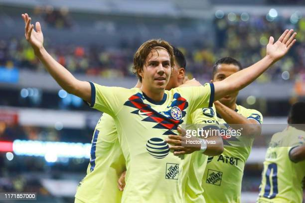 Francisco Cordova of America celebratess with teammates after scoring the first goal of his team during the 12th round match between America and...