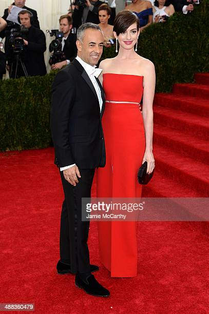 Francisco Costa and Anne Hathaway attend the 'Charles James Beyond Fashion' Costume Institute Gala at the Metropolitan Museum of Art on May 5 2014 in...