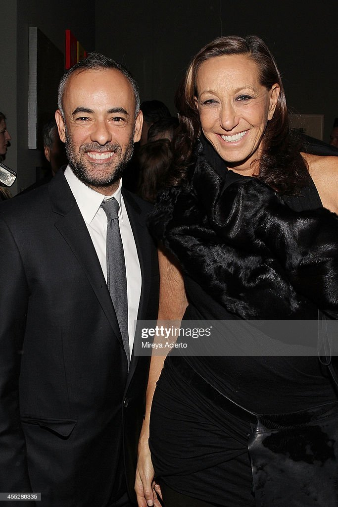 Francisco Costa and Donna Karan attend the ACRIA annual holiday dinner benefiting AIDS research on December 11, 2013 in New York City.
