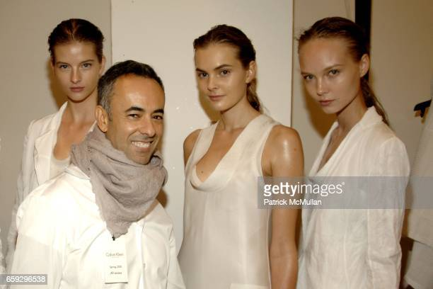 Francisco Costa and models backstage attend the Calvin Klein Collection Women's Spring 2010 Runway Show on September 17, 2009 in New York City.