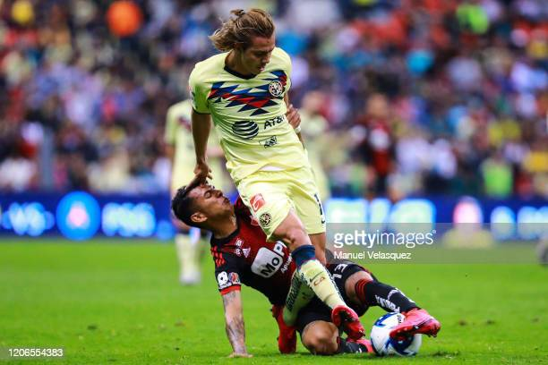 Francisco Córdova of america struggles for the ball against Ulíses Cardona of Atlas during the 6th round match between America and Atlas as part of...