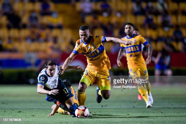 Francisco Córdova of América fights for the ball with Rafael De Souza of Tigres during the 14th round match between Tigres UANL and America as part...