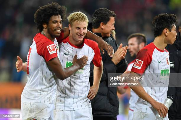 Francisco da Silva Caiuby and Martin Hinteregger of Augsburg hug after the Bundesliga match between FC Augsburg and RB Leipzig at WWKArena on...